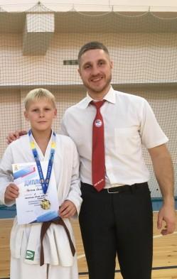Антон Немкин с воспитанником клуба Олимп